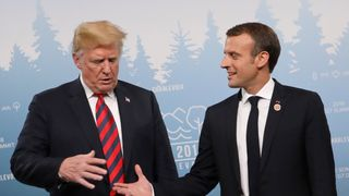 Trump looks warily at Macron's out-stretched hand Trump's personality politics left Theresa May invisible at G7 Trump's personality politics left Theresa May invisible at G7 skynews trump macron 4331881