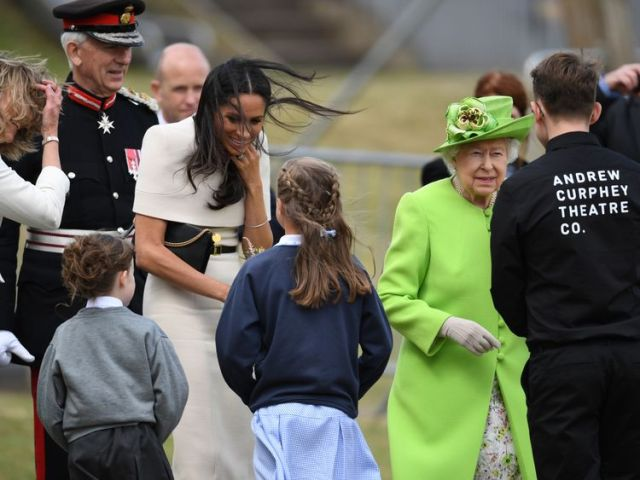 The Queen and Meghan speak to performers from the Andrew Curphey Theatre Company