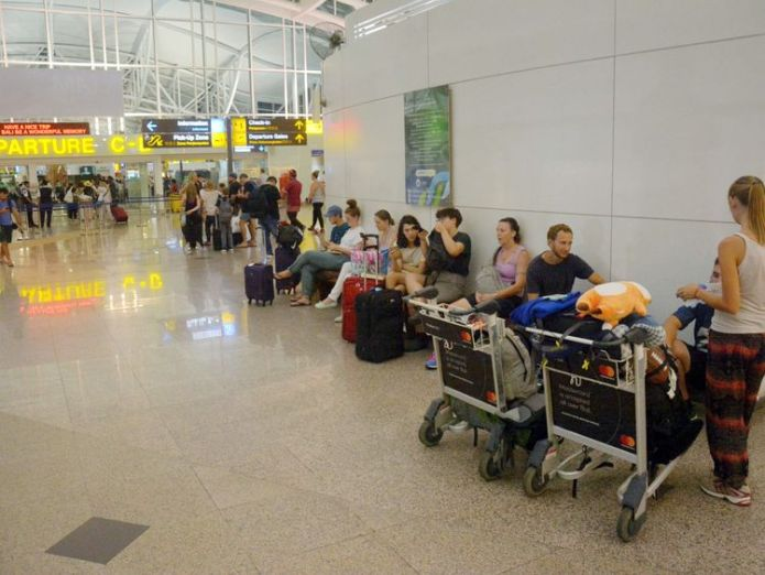 Passengers are seen waiting for flights outside the International Terminal at Ngurah Rai Airport after...  Volcano eruption leaves thousands stranded in Bali skynews bali indonesia airport 4348613