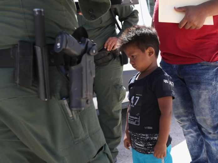A boy from Honduras is taken into custody Hundreds of lone children kept in cages in US Border Patrol 'prison' Hundreds of lone children kept in cages in US Border Patrol 'prison' skynews children separated 4339012