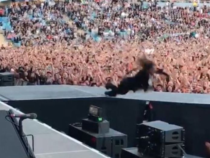 Grohl  lookalike and stuntman plunges off the stage Foo Fighters frontman Dave Grohl pranks fans with stage-fall stunt in Gothenburg Foo Fighters frontman Dave Grohl pranks fans with stage-fall stunt in Gothenburg skynews dave grohl foo fighters 4329400