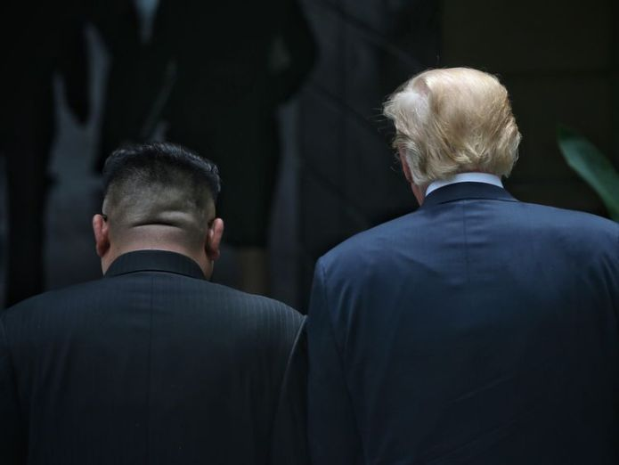 Donald Trump and Kim Jong Un at their historic summit on Sentosa Island Confusion as North Korea says US will lift sanctions Confusion as North Korea says US will lift sanctions skynews donald trump kim jong un 4334593