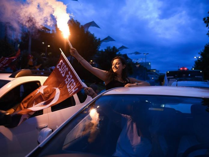 Recep Tayyip Erdogan's supporters celebrate in Istanbul Erdogan 'wins' Turkey's presidential election Erdogan 'wins' Turkey's presidential election skynews istanbul erdogan supporters 4345033