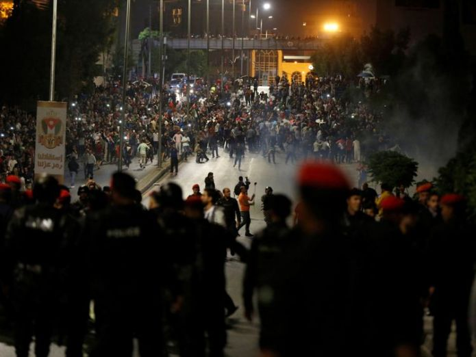 Demonstrators clash with riot police during a protest in Amman King Abdullah of Jordan blames regional turmoil for economic crisis amid protests King Abdullah of Jordan blames regional turmoil for economic crisis amid protests skynews jordan protests 4327034