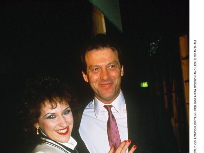 Grantham pictured with his on-screen wife - Angie Watts - played by Anita Dobson  Ex-EastEnders star Leslie Grantham 'in critical condition' in hospital skynews leslie grantham anita dobson 4333957