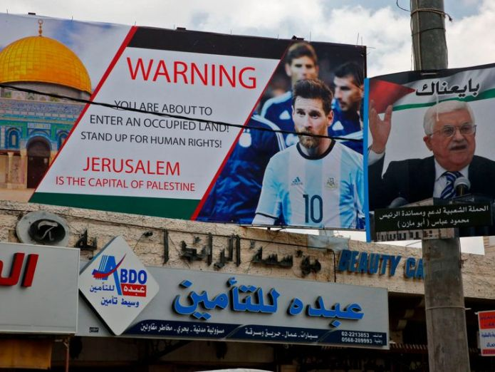 """A pro-Palestinian billboard in the West Bank pictures Messi and states: """"Stand up for human rights."""" Argentina cancels Israel match amid 'threats' against Lionel Messi Argentina cancels Israel match amid 'threats' against Lionel Messi skynews lionel messi argentina 4329149"""