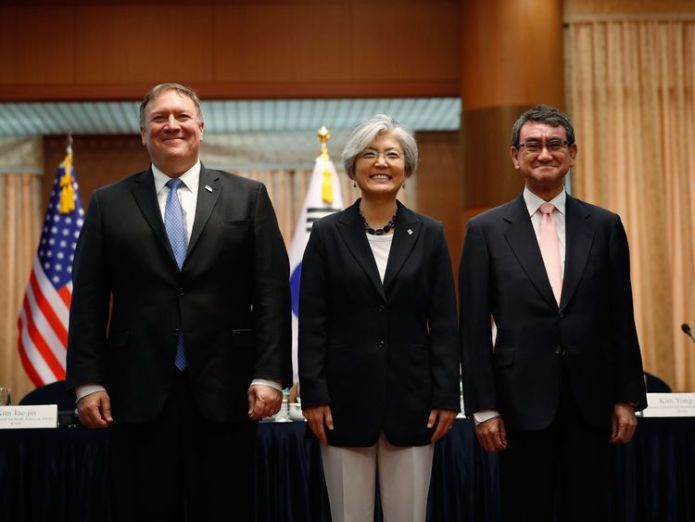 Mike Pompeo poses with the South Korean foreign minister (middle) and the Japanese foreign minister Sanctions will stay until nukes go, US tells North Korea Sanctions will stay until nukes go, US tells North Korea skynews mike pompeo korea 4335556