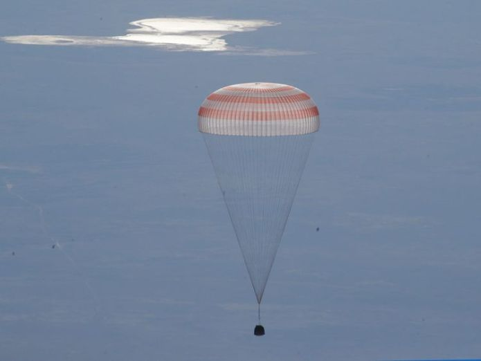 A Russian Soyuz MS-07 space capsule descends about 150km (90 miles) south-east of the Kazakh town of Dzhezkazgan Astronauts leave International Space Station and return to Earth after 2,600 orbits Astronauts leave International Space Station and return to Earth after 2,600 orbits skynews soyuz iss space 4327200