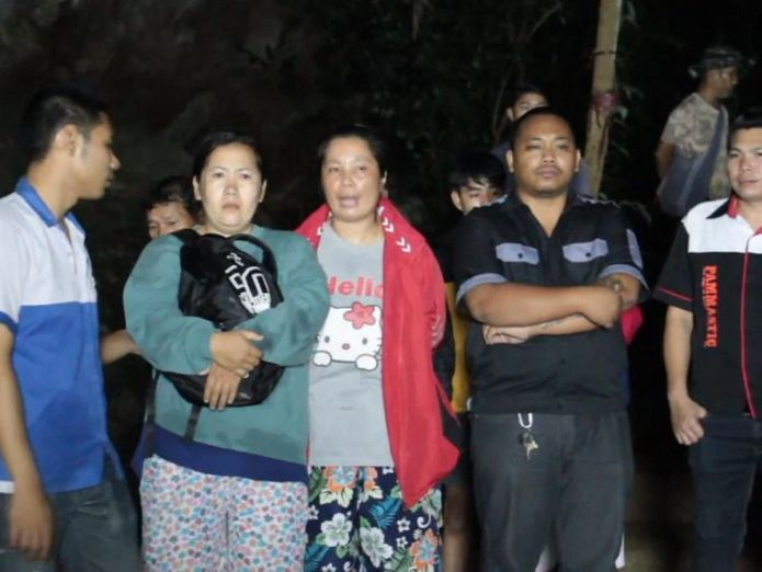 Relatives have been nervously waiting for news at the scene Fears for youth football team trapped in Thai cave Fears for youth football team trapped in Thai cave skynews thailand rescue 4344990