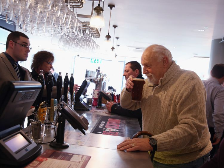 BEACONSFIELD, ENGLAND - JANUARY 21: The JD Wetherspoon pub, the 'Hope And Champion', opens for the first day of trading in the Extra Motorway Service Area at junction 2 of the M40 motorway on January 21, 2014 in Beaconsfield, England. The Hope and Champion is England's first pub to open in a motorway service area and will open from 4am until 1am on seven days a week.