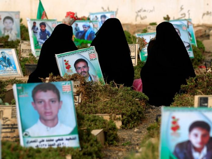 Yemenis visit the graves of relatives at a cemetery in Sanaa on 15 June Saudi-led forces 'seize control of Hodeida airport' Saudi-led forces 'seize control of Hodeida airport' skynews yemen conflict 4337607