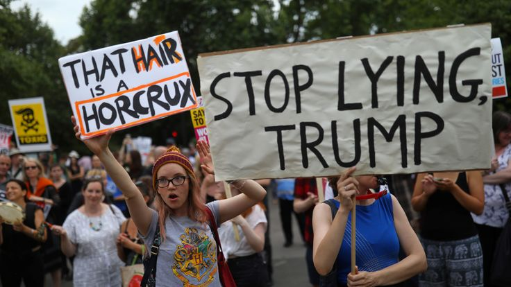 Demonstrators protest next to the specially erected fence surrounding the U.S. ambassador's residence, Winfield House, where U.S. President Donald Trump and the First Lady Melania Trump are staying, in London, Britain, July 12, 2018. REUTERS/Simon Dawson