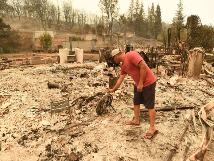 Wade Brilz looks at what remains of his burned home during the Carr fire in Redding  Monster California blaze kills two firefighters skynews carr fire redding california 4373886