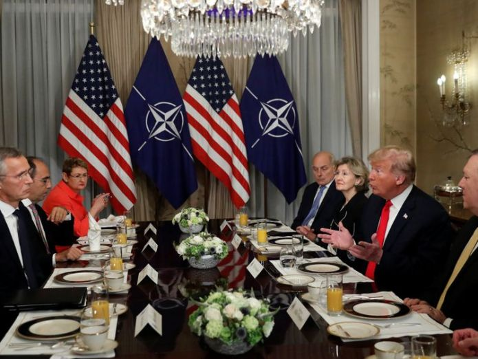 Donald Trump and NATO Secretary General Jens Stoltenberg attend a bilateral breakfast ahead of the NATO Summit in Brussels  Donald Trump claims Germany is 'captive' of Russia in fiery row at NATO summit skynews donald trump jens stoltenberg 4358931