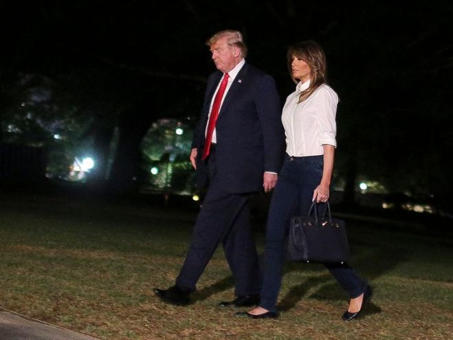 Donald and Melania Trump return to the White House after the summit in Helsinki with Vladimir Putin