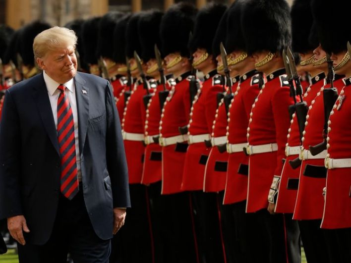 Donald Trump inspects a Guard of Honour, formed of the Coldstream Guards at Windsor Castle in Windsor, England, Friday, July 13, 2018