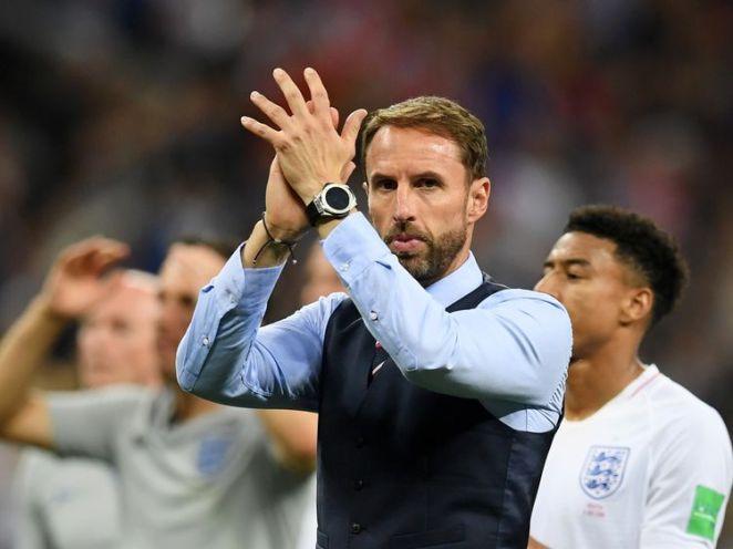Gareth Southgate applauds England supporters at Moscow's Luzhniki Stadium