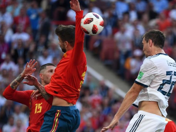 Spain's Gerard Pique handles the ball in the box to concede a penalty  Russia stun Spain on penalties to make last eight skynews gerard pique spain 4350675
