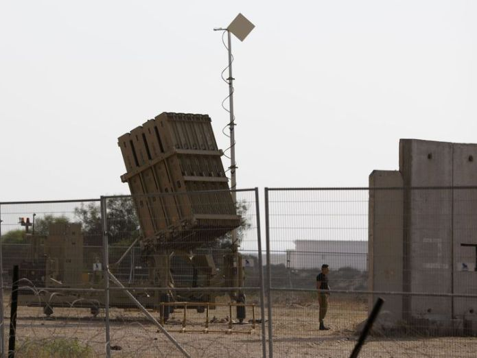 An Israeli soldier stands next to an Iron Dome defence system, designed to intercept and destroy incoming short-range rockets and artillery shells, near the city of Ashkelon on July 14, 2018. - Rockets were fired at southern Israel from Gaza, the Israeli military said, without causing any casualties. (Photo by Ahmad GHARABLI / AFP) (Photo credit should read AHMAD GHARABLI/AFP/Getty Images)