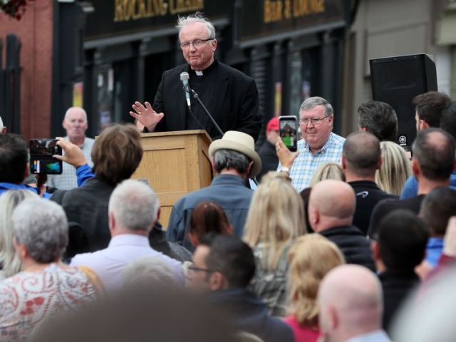 Catholic bishop of Derry Donal McKeown speaking at a rally on Fahan street, Londonderry, in protest against the ongoing violence and disorder
