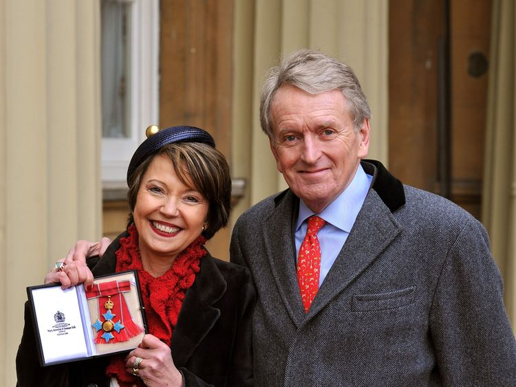 Lady Catherine Meyer proudly holds her Commander of the British Empire(CBE) medal with her husband Sir Christopher, after it was presented to her by the Prince of Wales during the Investiture Ceremony at Buckingham Palace in central London in 2013