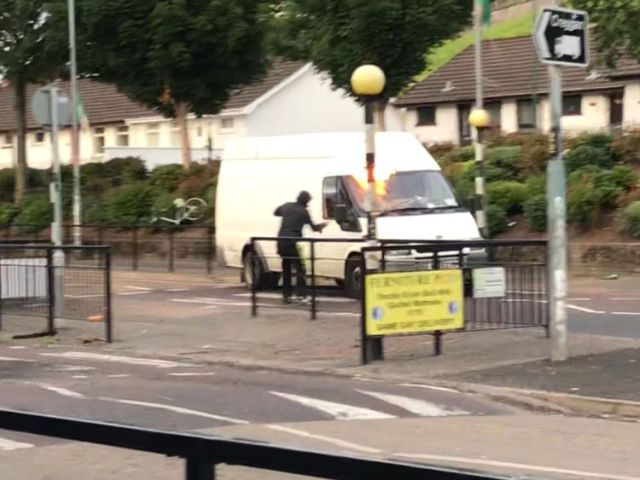 A rioter threw a petrol bomb at a van from close range in Londonderry