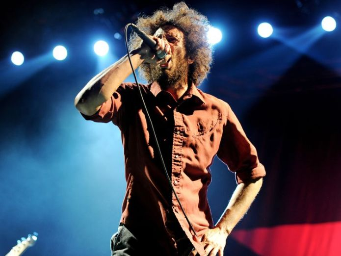 Zack de la Rocha of Rage Against The Machine is keen not to be associated with Mr Farage   Rage Against The Machine send Nigel Farage legal warning over podcast skynews rage against the machine 4359782