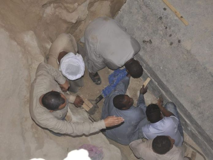 Egyptian excavation workers outside the site of the newly discovered giant black sarcophagus  Mystery 30-ton sarcophagus in Egypt found to contain three mummies skynews sarcophagus egypt 4366342