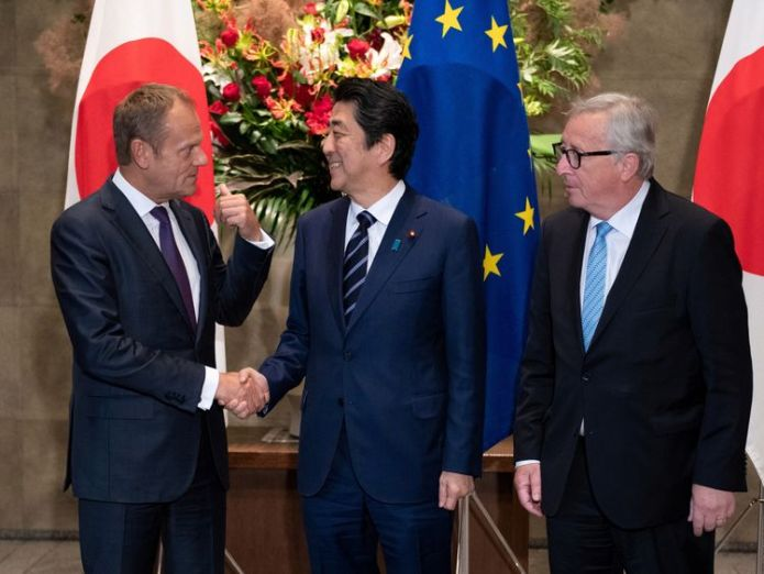 Japanese Prime Minister Shinzo Abe shakes hands with European Council President Donald Tusk  European Union signs its biggest ever trade deal after striking agreement with Japan skynews shinzo abe donald tusk 4364295