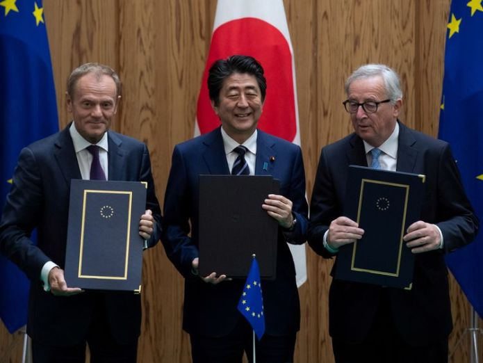 Mr Abe shows off the deal with European Commission President Jean-Claude Juncker and European Council President Donald Tusk  European Union signs its biggest ever trade deal after striking agreement with Japan skynews shinzo abe jean claude juncker 4364297