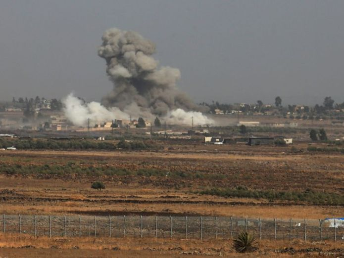 Smoke following an explosions in Syria is seen from the Israeli-occupied Golan Heights near the Israeli Syrian border July 25, 2018. REUTERS/Ammar Awad  More than 200 dead as IS hits vegetable market in co-ordinated blasts in Syria skynews syria islamic state 4371148