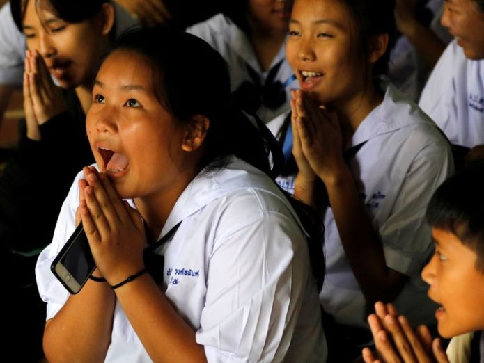 Classmates react after they hear that some of the 12 boys trapped inside the cave have been rescued  Boys 'doing well' after spending night in hospital skynews thailand cave rescue 4357140