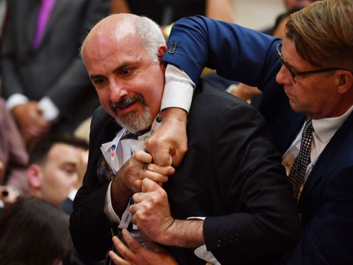 The man being removed from the news conference  Man dragged out of Trump-Putin news conference skynews trump putin 4363644