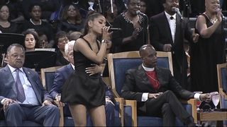 Ariana Grande, a friend of Aretha, takes to the stage and performs Natural Women