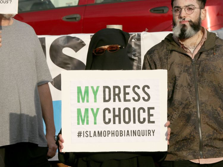 A woman wearing a burka joins a protest near Boris Johnson's constituency office