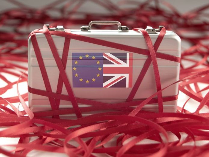 Red tape around a briefcase with european and british flags   BCC downgrades growth forecast, blaming Brexit skynews eu uk brexit red tape 4398743