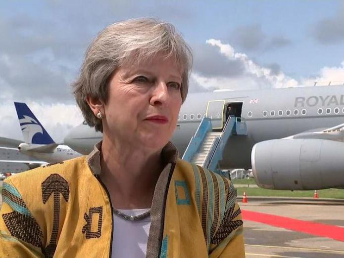 Theresa May lands in Abuja, Nigeria to discuss trade and security as part of her 3-day trip to the Africa  May calls for 'amicable solution' to scallops row after French fishermen 'attack' skynews theresa may nigeria 4404939