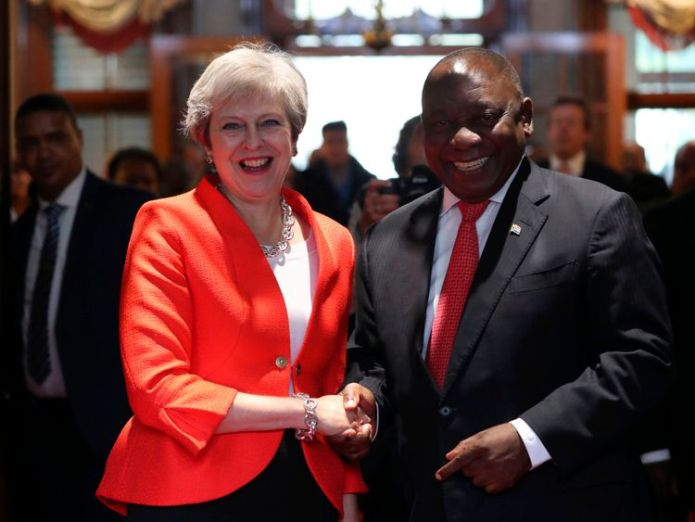 Britain's Prime Minister Theresa May is greeted by South African President Cyril Ramaphosa in Cape Town  Theresa May in 'unashamed' vow to ensure foreign aid spending benefits UK skynews theresa may south africa 4403488