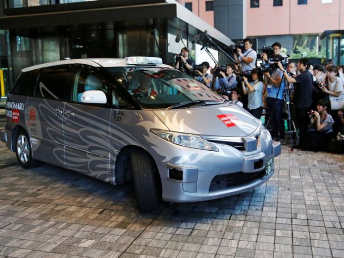ZMP Inc's RoboCar MiniVan, a self-driving taxi based on a Toyota Estima Hybrid car, operated by Hinomaru Kotsu Co, is seen at the start of its services proving test in Tokyo, Japan August 27, 2018. REUTERS/Toru Hanai  Passengers hail 'world first' test run for self-driving taxi in Tokyo skynews tokyo japan taxi 4403392