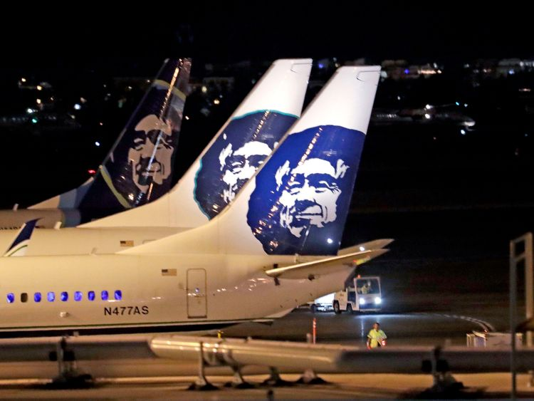 """Alaska Airlines planes sit on the tarmac at Sea-Tac International Airport Friday evening, Aug. 10, 2018, in SeaTac, Wash. Officials at Sea-Tac International Airport say an Alaska Airlines plane that was stolen by an airline employee and has crashed in Washington state. Airport officials said in a tweet Friday night that an airline employee """"conducted an unauthorized takeoff without passengers."""" (AP Photo/Elaine Thompson)"""