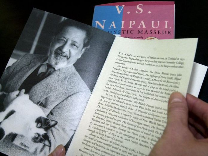 """A person displays a book with the title """"Mystic masseur"""" written by V.S. Naipaul at the Frankfurt book fair October 11, 2001.   Nobel Prize-winning author V S Naipaul dies skynews v s naipaul novel mystic masseur 4387560"""