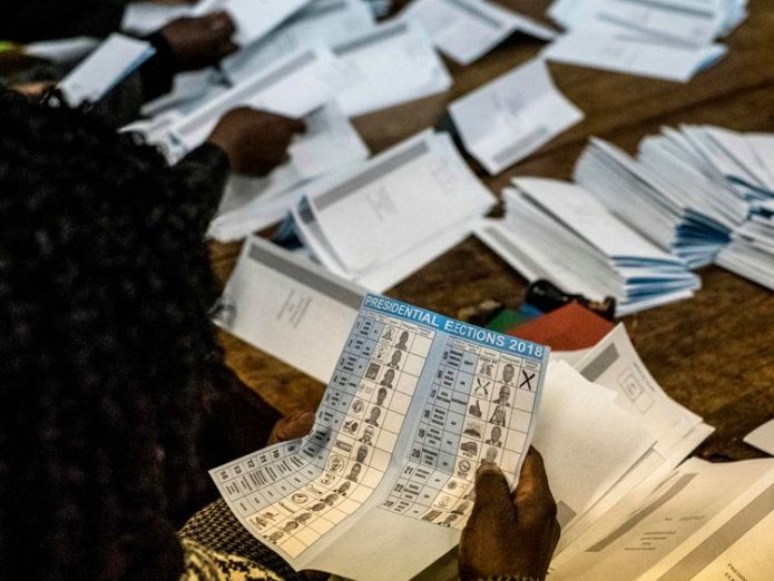 Election officials tally presidential candidates' ballots during counting  Zimbabwe's President Mnangagwa must defend 'fake and unverified' election skynews zimbabwe election 4377359