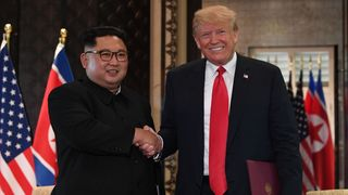 North Korean leader Kim Jong-Un shakes hands with US President Donald Trump during a historic summit of the two nations.