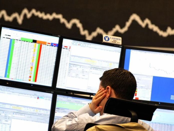 A broker looks at his screens  Next financial crisis 'has begun and will be worse than 2008 crash,' economists warn banker broker generic sky news 4420595
