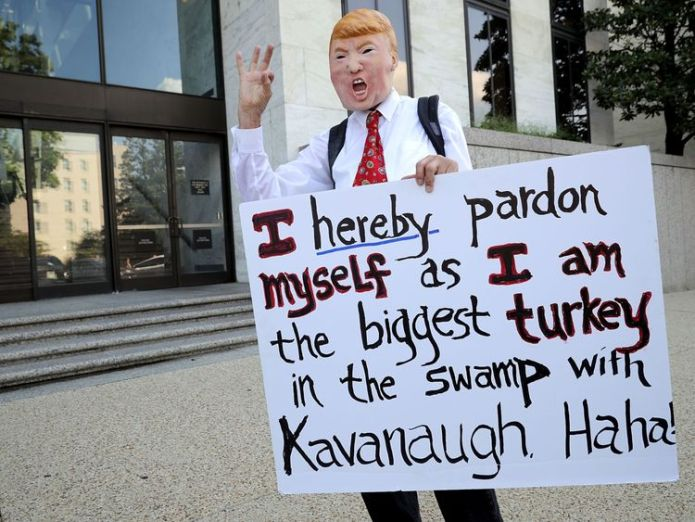 A protester wore a Donald Trump as he demonstrated outside the Hart Senate Office   Brett Kavanaugh willing to 'refute' sexual assault allegation before Senate panel skynews brett kavanaugh donald trump 4424441