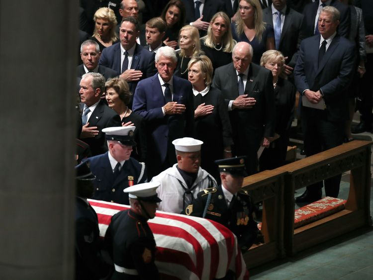 WASHINGTON, DC - SEPTEMBER 1: (L-R) Former U.S. President George W. Bush, Laura Bush, Former U.S. President Bill Clinton, former Secretary of State Hillary Clinton, former U.S. Vice President Dick Cheney, Lynne Cheney, and former U.S. Vice President Al Gore stand as the casket is brought in for the funeral service for U.S. Sen. John McCain at the National Cathedral on September 1, 2018 in Washington, DC. The late senator died August 25 at the age of 81 after a long battle with brain cancer. McCa