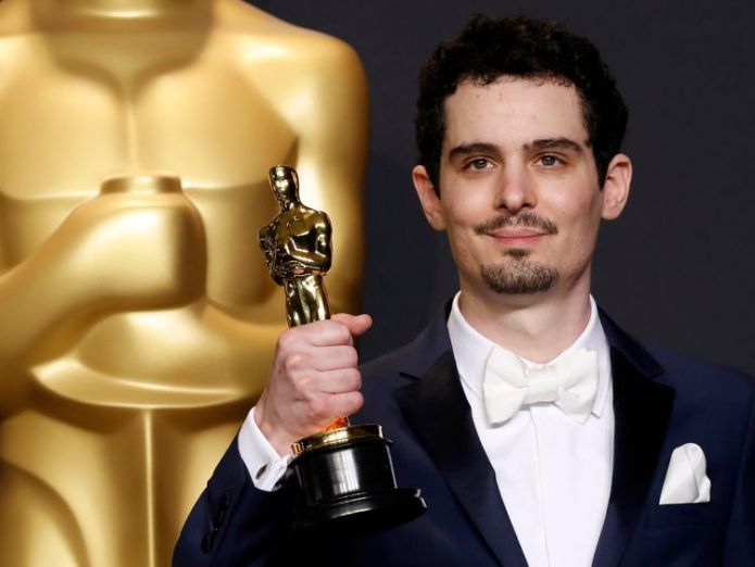 Damien Chazelle won best director at the 2017 Oscars  Director Damien Chazelle 'surprised' at Donald Trump's criticism of Neil Armstrong biopic skynews damien chazelle oscars 4436989