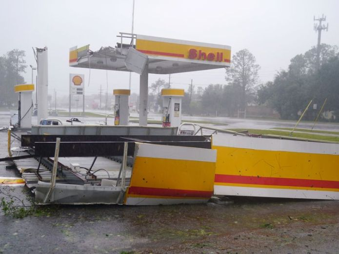 A gas station with its roof blown off is seen as Hurricane Florence comes ashore in Wilmington