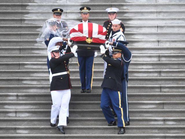A Military Honour Guard carries Senator McCain's coffin