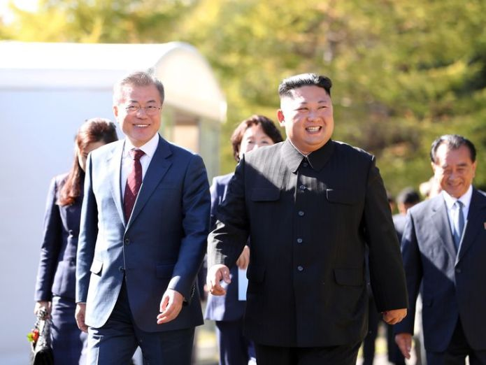 North Korea's leader Kim Jong Un (R) walk with South Korean President Moon Jae-in (L) during a visit to Samjiyon guesthouse in Samjiyon on September 20, 2018  Second North Korea summit 'quite soon' skynews moon jae in kim jong un 4432193